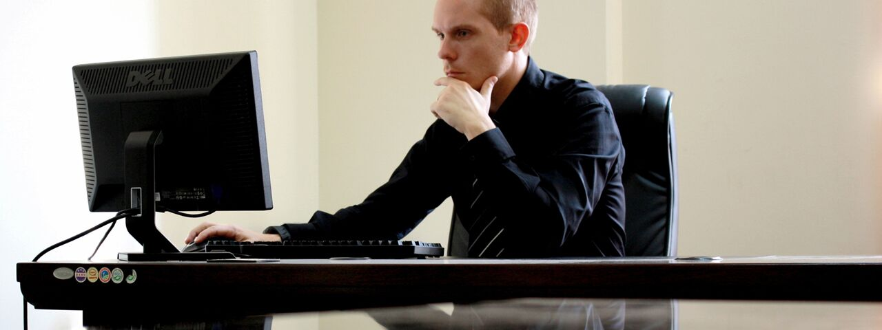 Man working on computer, suffering computer vision